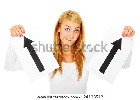 A picture of a beautiful woman holding two arrows and trying to choose the correct direction over white background