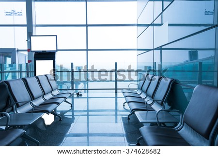 A picture of a brand new departure lounge at the airport, blue tone - stock photo