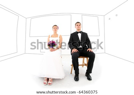 A picture of a bride and groom in their new, empty house