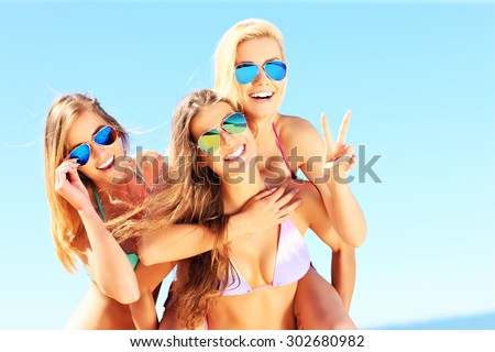 A picture of a group of women having fun on the beach - stock photo