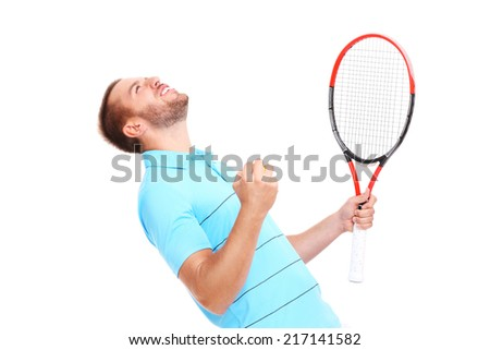 A picture of a handsome tennis player cheering over white background - stock photo