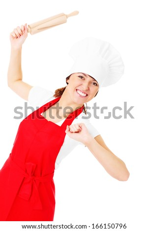A picture of a happy woman posing with a rolling pin over white background
