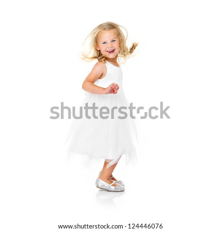 A picture of a little ballerina dancing over white background - stock photo
