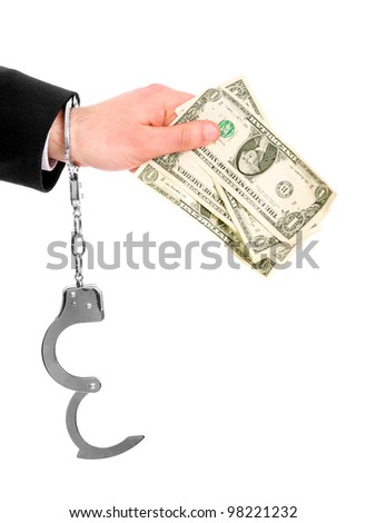 A picture of a male hand in cuffs holding dollars over white background - stock photo