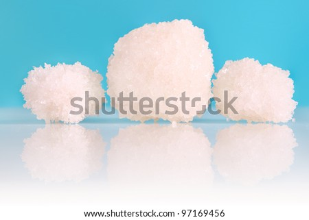A picture of a natural balls of salt from the Dead Sea over blue background - stock photo