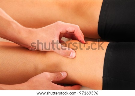 A picture of a physio therapist giving a knee massage - stock photo