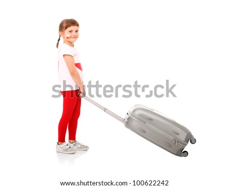 A picture of a Polish little girl in national colors pulling a suitcase over white background - stock photo