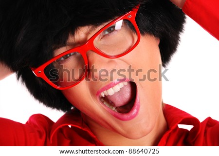 A picture of a pretty young woman in a winter hat and red glasses singing over white background
