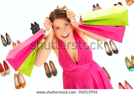 A picture of a pretty young woman shopping for shoes over white background - stock photo
