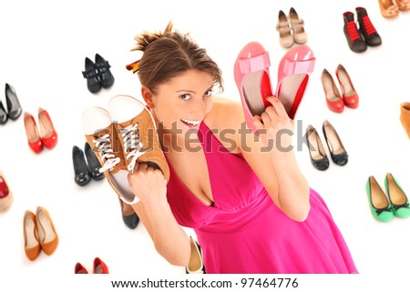 A picture of a pretty young woman shopping for shoes over white background