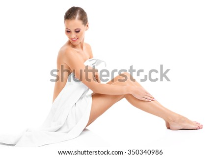 A picture of a sensual woman in a white towel over white background