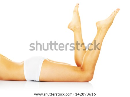 A picture of a sexy woman lying over white background - stock photo