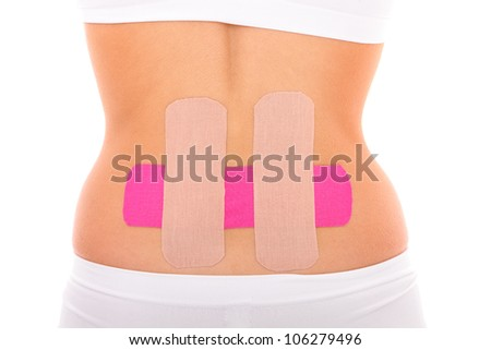 A picture of a special physio tape put on the back muscle over white background - stock photo