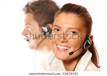 A picture of a team of young call center workers, pretty woman in the foreground - stock photo