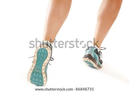 A picture of a woman's legs running on a white background.. - stock photo