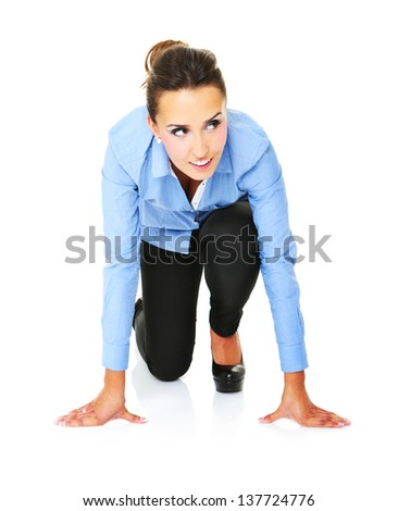 A picture of a young businesswoman ready to start a race over white background - stock photo
