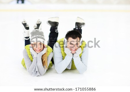 A picture of a young coupleresting on an ice rink - stock photo