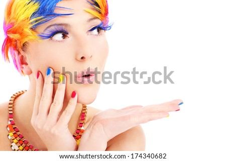 A picture of a young woman holding balloons over white background - stock photo
