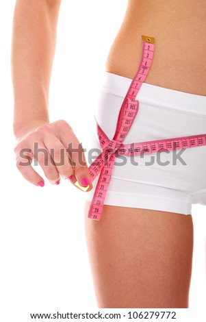 A picture of a young woman with a tape measure bow on her hip over white background