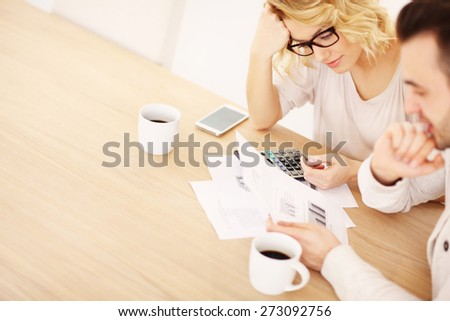 A picture of an adult couple working on documents at home - stock photo