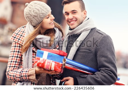 A picture of cheerful young people doing Christmas shopping - stock photo