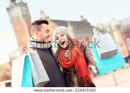 A picture of cheerful young people with shopping bags - stock photo