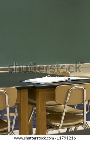 a picture of desks and chalkboard in school classroom - stock photo