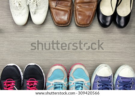 A picture of difference, Shot of several design of men and women shoes, The compare of leather and sport shoes. - stock photo