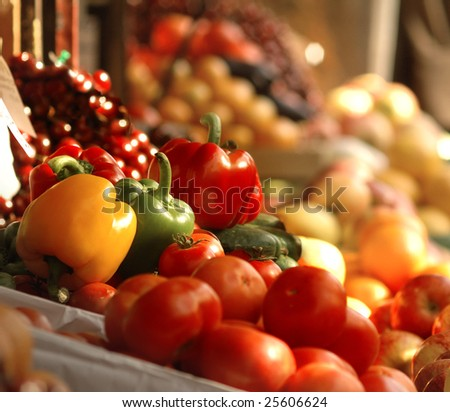 A picture of fresh tomatoes, bell peppers and other vegetables.  Look for more in MY PORTFOLIO - stock photo