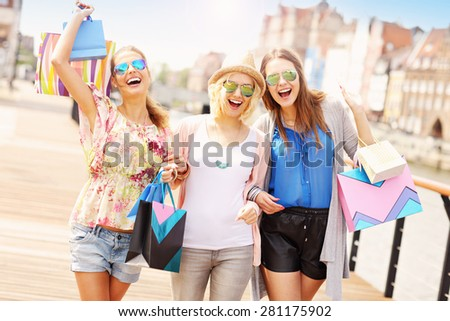 A picture of group of friends shopping in the city - stock photo