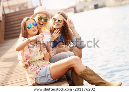 A picture of group of friends taking selfie in the city - stock photo
