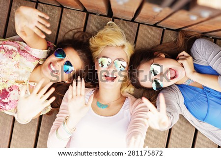 A picture of group of happy friends hanging out in the city - stock photo