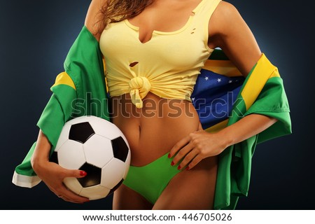 A picture of happy Brazilian fan cheering with flag - stock photo