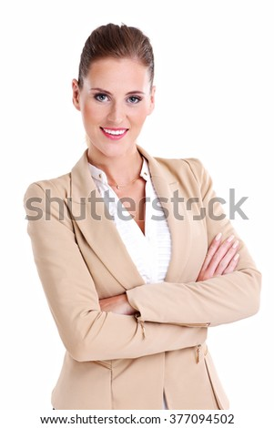 A picture of happy businesswoman with her arms folded over white background