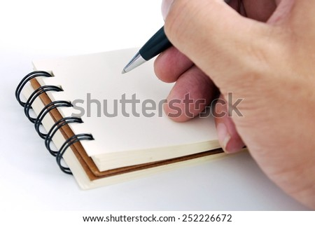 A picture of holding pen with  notebook - stock photo