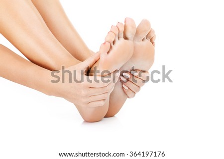 A picture of sensual female feet over white background