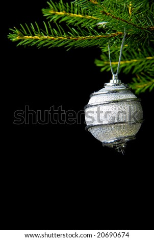 a picture of some silver christmas decoration isolated on black - stock photo