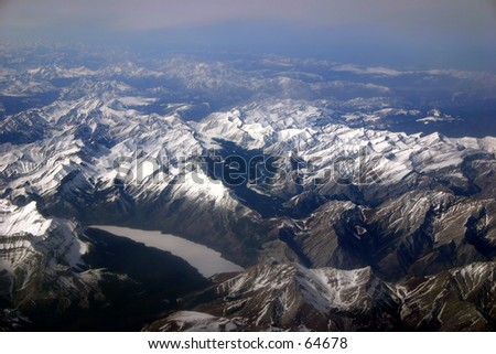 A picture of the Canadian Rockies at ~35 000 feet. - stock photo