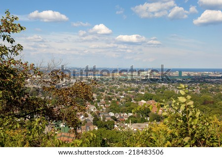 A picture of the lower city of Hamilton from the mountain, with the harbour in the background.  - stock photo