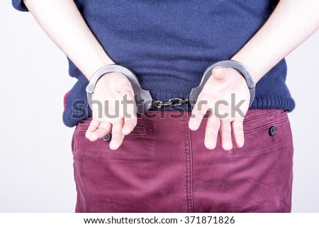 a picture of the offender in handcuffs - stock photo
