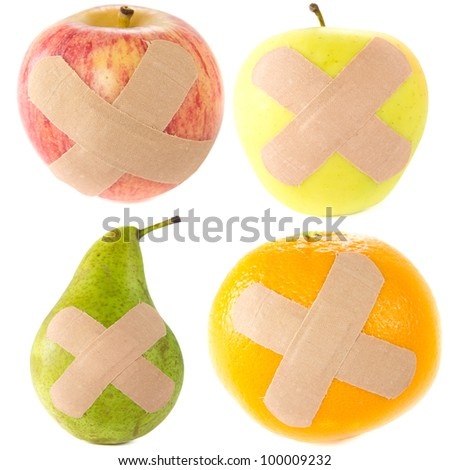 A picture of two apples, a pear, and a orange with bandages..Sick fruit..