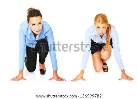 A picture of young businesswomen ready to start a race over white background - stock photo