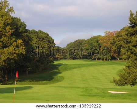A Picturesque Hole on a Golf Course With Approaching Autumn Thunderstorm
