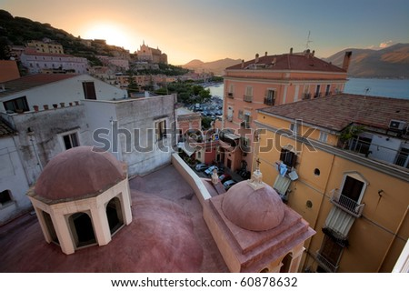 A picturesque italian sunset with a view above the dome of a church on the gulf of Gaeta, Italy - stock photo