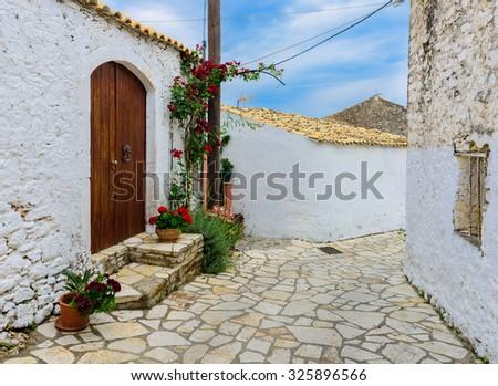 A picturesque street in Afionas Garden Village, Corfu, Greece. - stock photo
