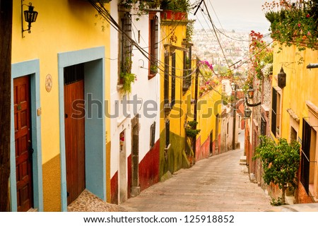 A picturesque street scene in charming San Miguel de Allende, Mexico - stock photo