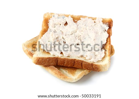 A piece of baked bread with mayonnaise tuna isolated on white background.