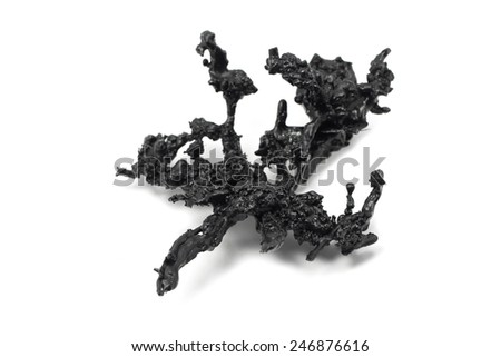 a piece of black plastic on a white background - stock photo