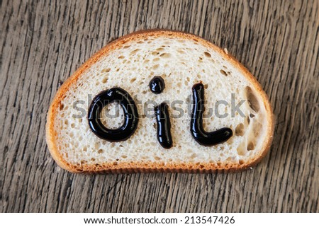 A piece of bread with oil butter on it - stock photo