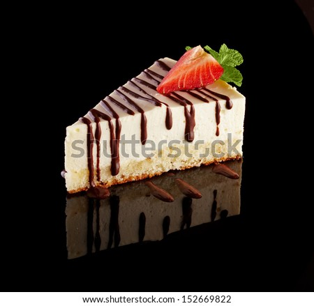 A piece of cheesecake on the black mirror - stock photo